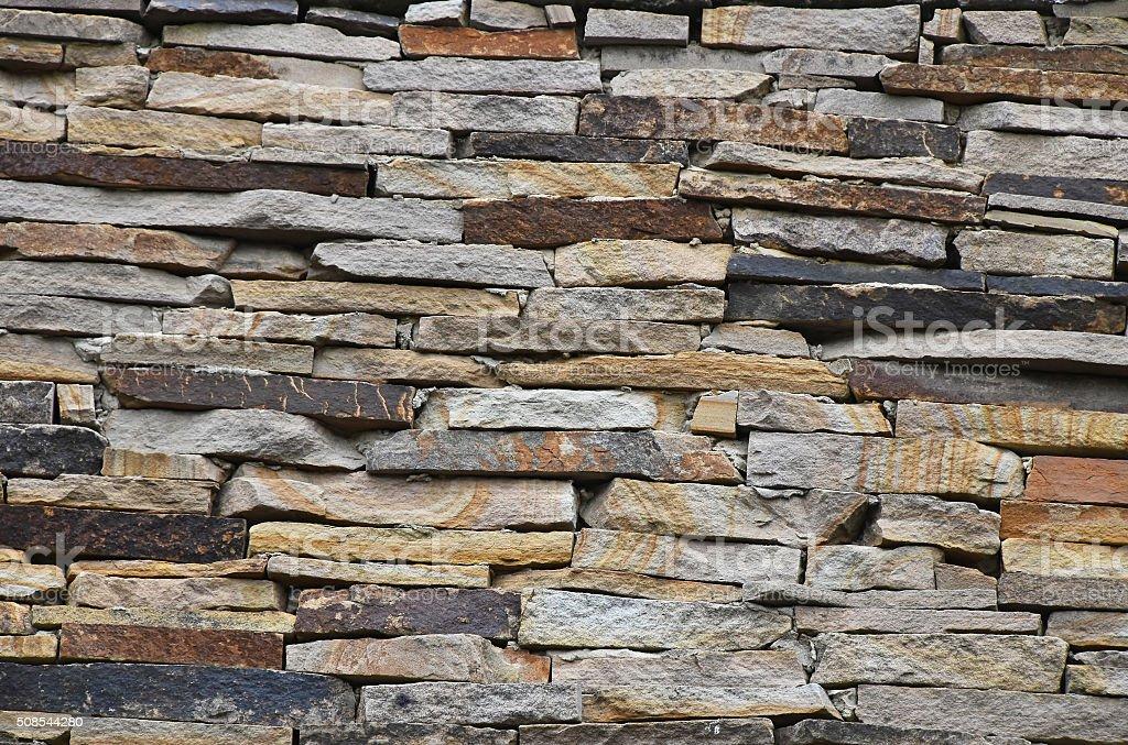 Old stone layered wall royalty-free stock photo