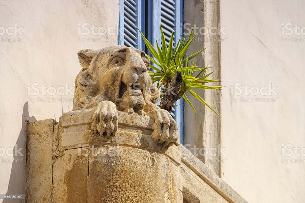old stone lion sculpture stock photo