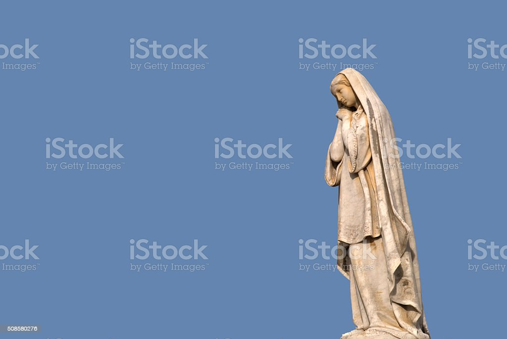 Old stone Madonna stock photo