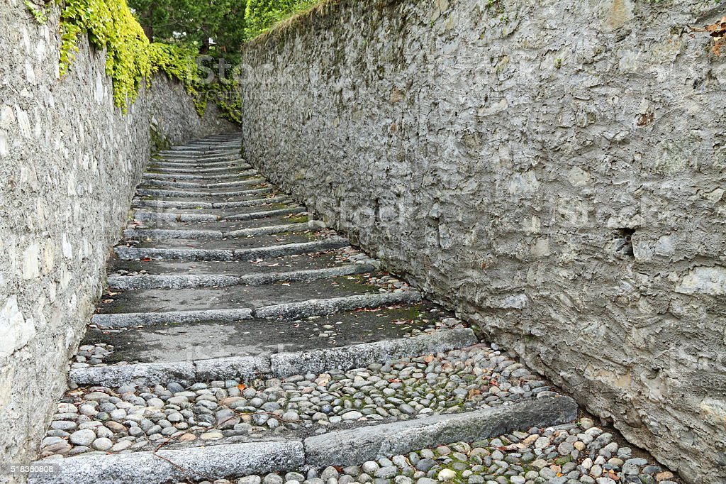 old stone pathway with steps stock photo