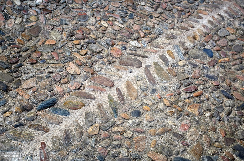 Old stone pavement as a background, top view, horizontal stock photo