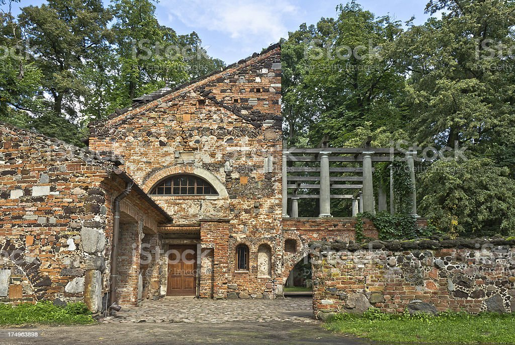 Old stone residential home in the park royalty-free stock photo