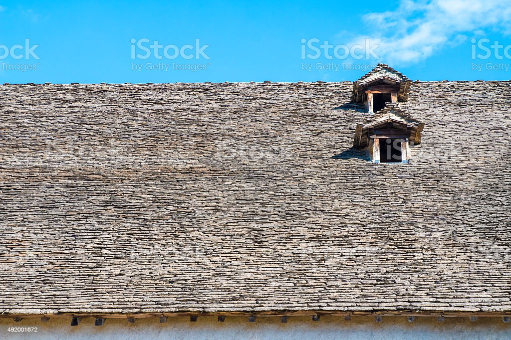 Old stone roof front view with dormers windows in France stock photo