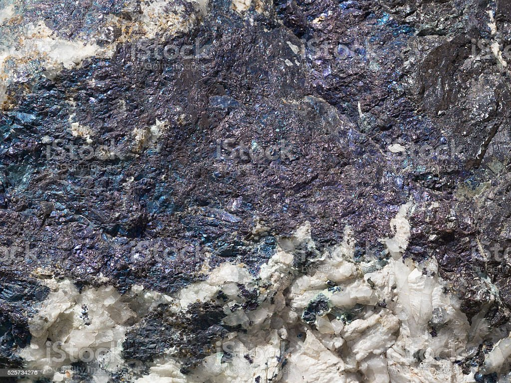 old stone spotted with blue streaks stock photo