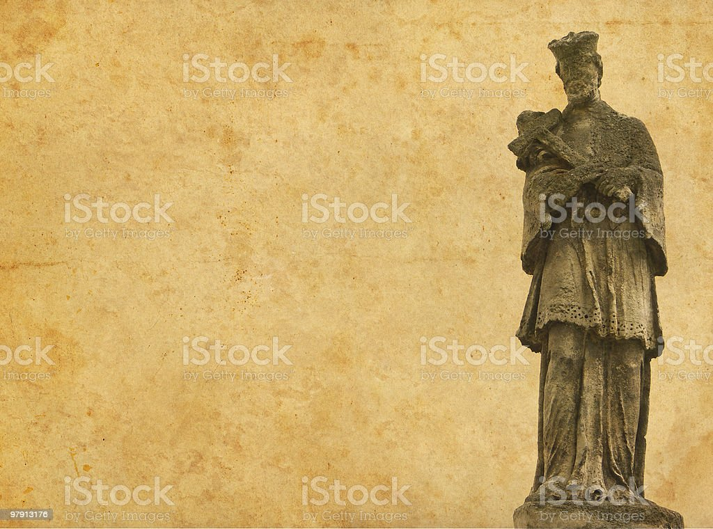 old stone statue of a saint man on aged paper royalty-free stock photo