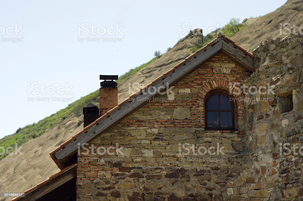 Old stone wall and tiled roof. David Gareja monastery, Georgia stock photo