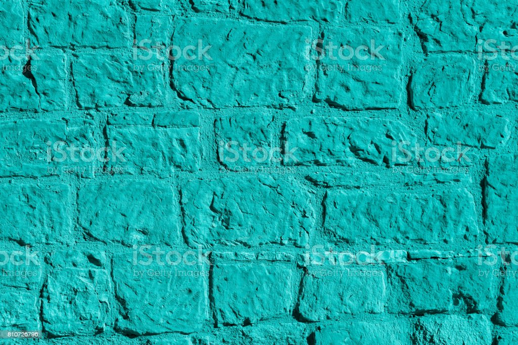 Old stone wall in aqua color stock photo