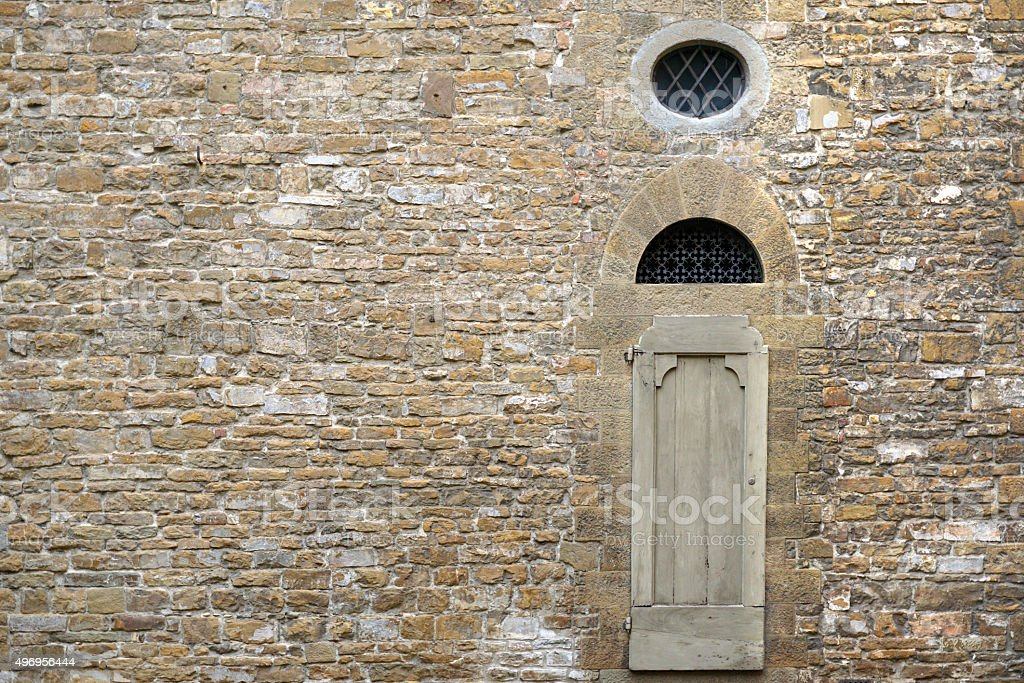 Old stone wall in Florence, Italy stock photo
