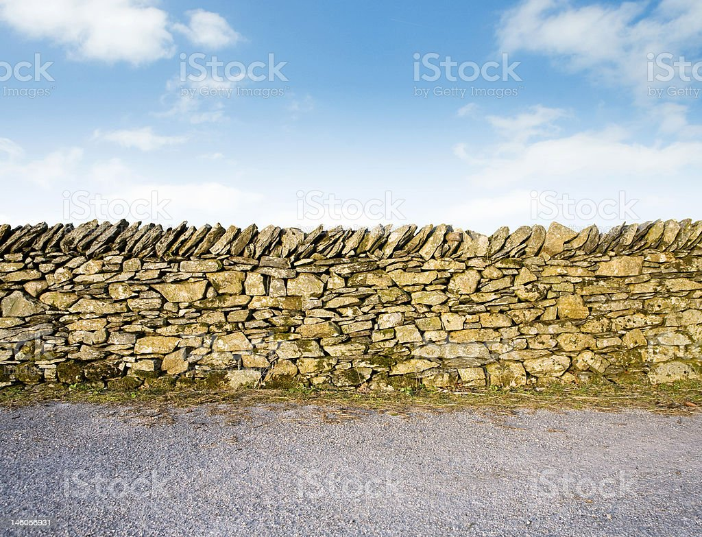 Old Stone Wall with blue sky stock photo