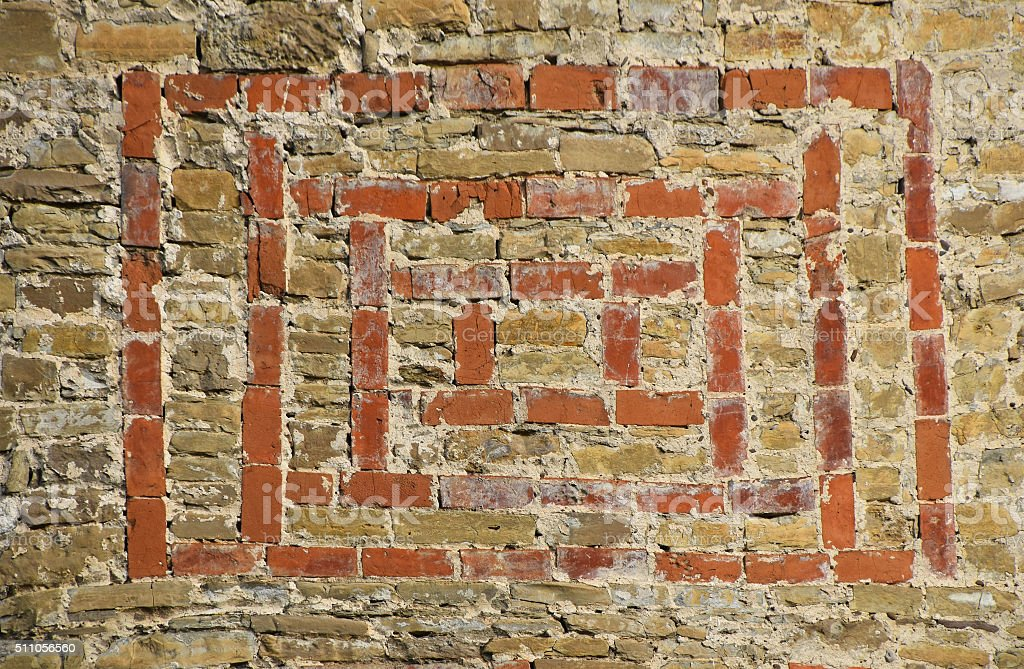 Old stone wall with red bricks hacking royalty-free stock photo