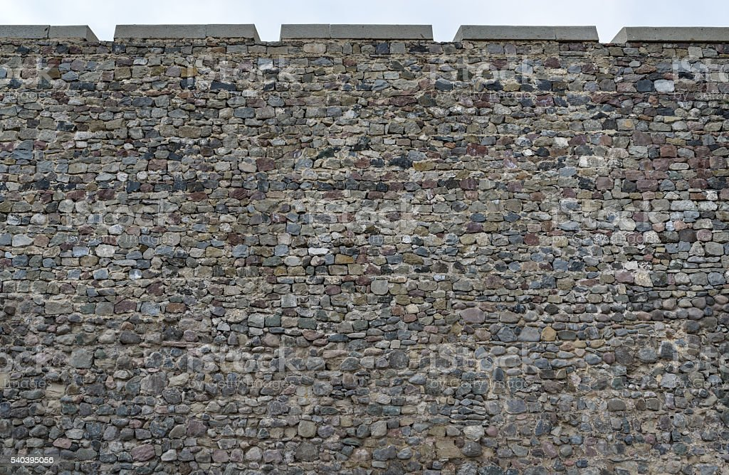 old stonework of  fortress wall stock photo