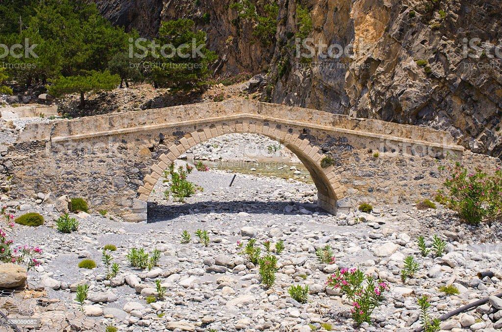 Old stony bridge in Samaria Gorge, Crete stock photo