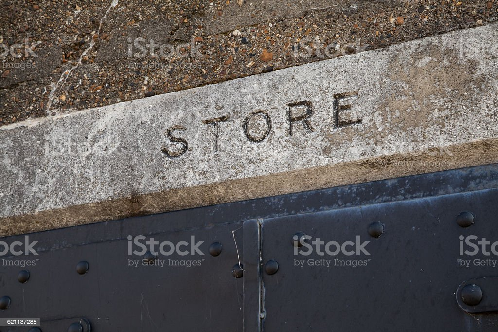 Old Store Sign in Stone stock photo