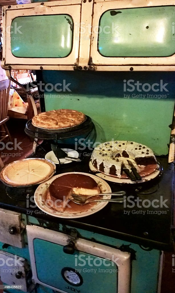 old stove with cakes stock photo