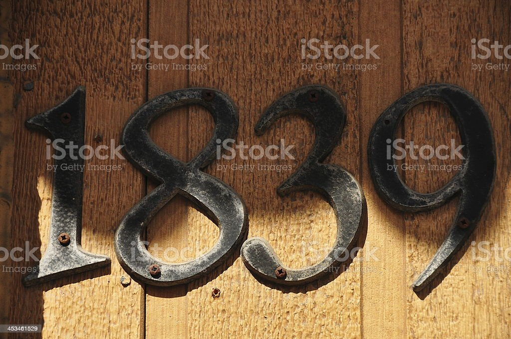 Old street address number historical year 1839  past on wood stock photo