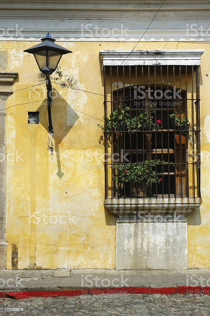 Old Street Lamp and Window in Antigua, Guatemala royalty-free stock photo