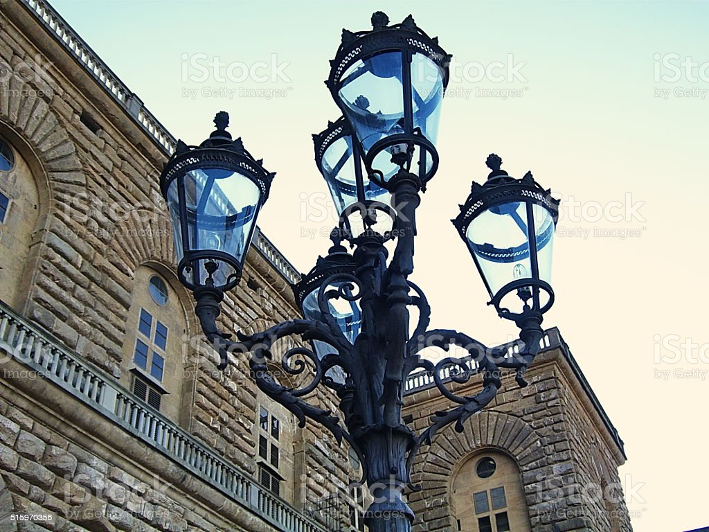 Old street lamp in Pitti square, Florence stock photo