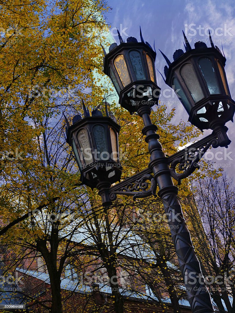Old street light beside catholic church stock photo