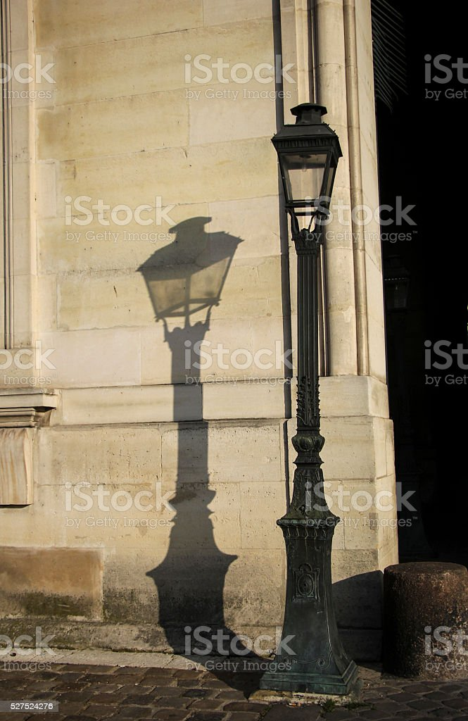 Old street lighting in street of Paris in the morning. stock photo