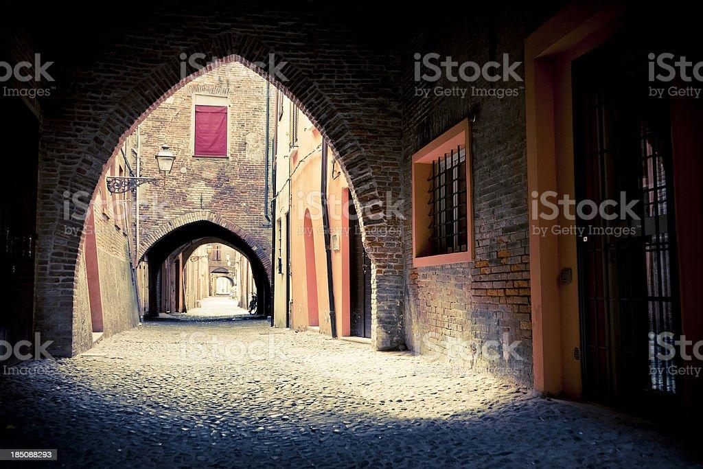 Old street of Ferrara, Italy. stock photo