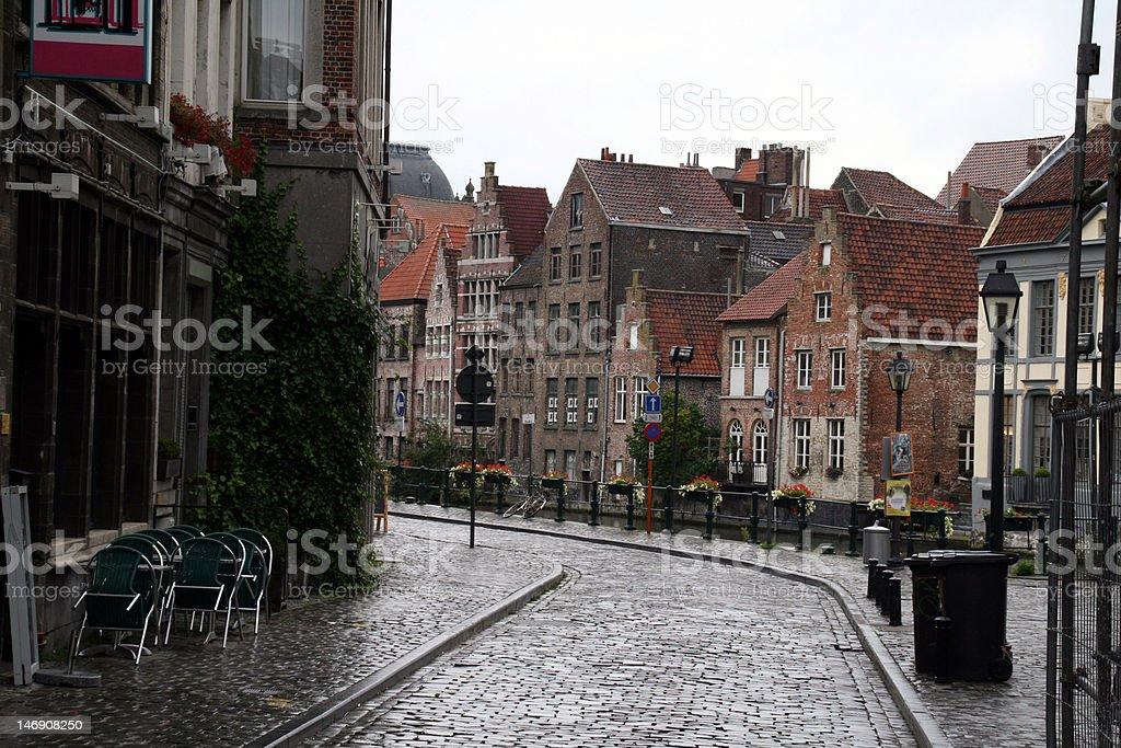 old street on a rainy day stock photo