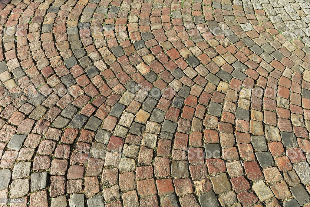 Old street paved with cobblestone. Paris, France stock photo