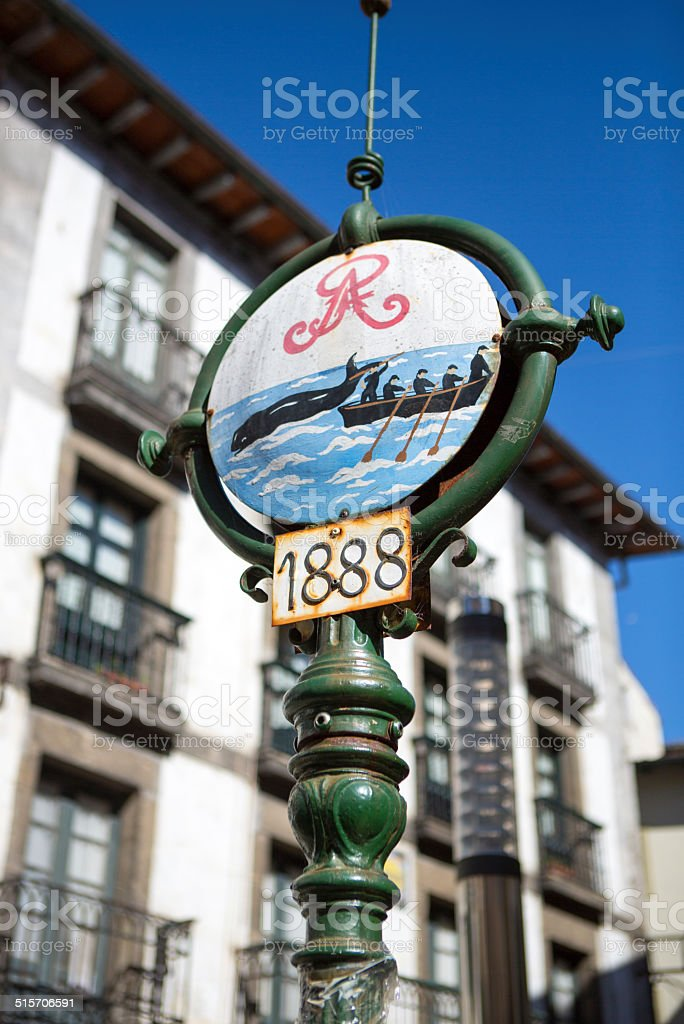 Old street sign with fishers fishing wales in Lekeitio stock photo