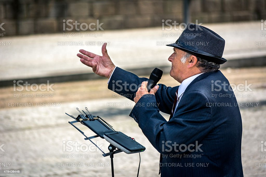 Old street singer in Porto, Portugal. stock photo