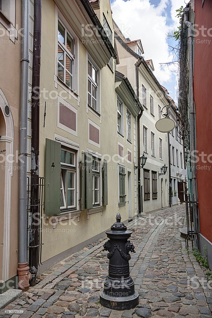 Old street with cobbled floor in Riga Latvia royalty-free stock photo