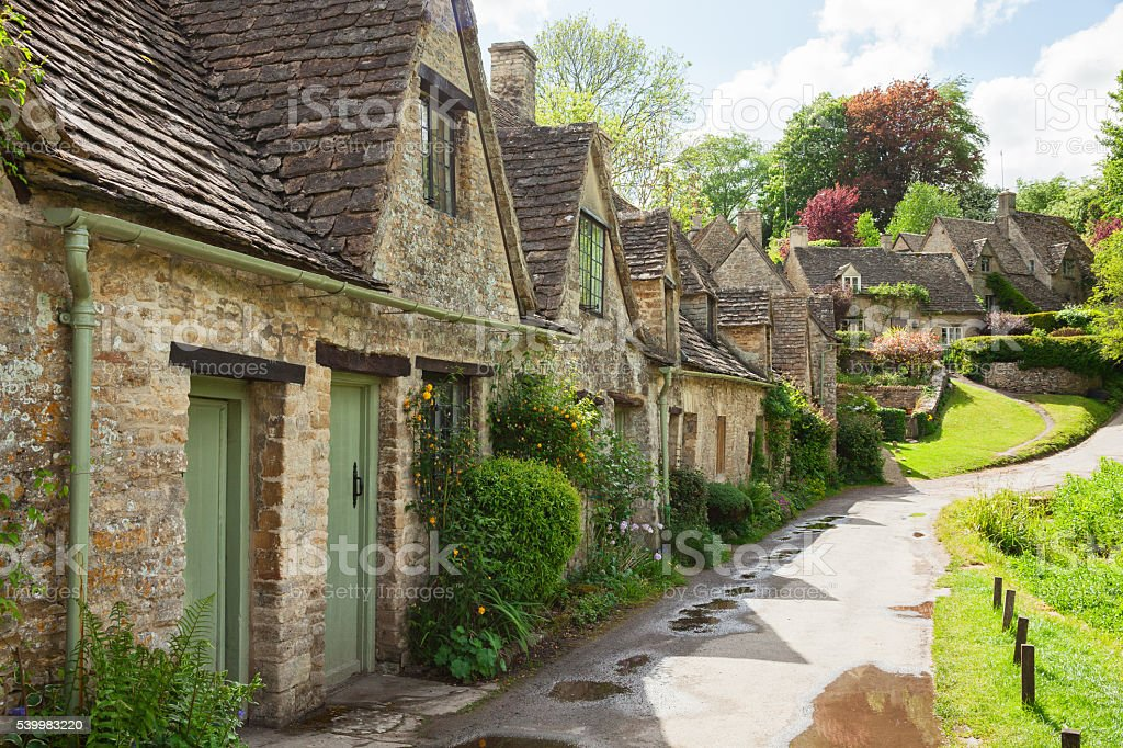 Old street with traditional cottages. stock photo