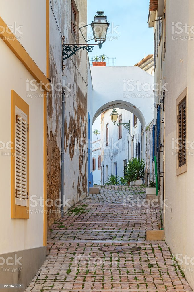 Old streets with pavement of the town Albufeira. stock photo