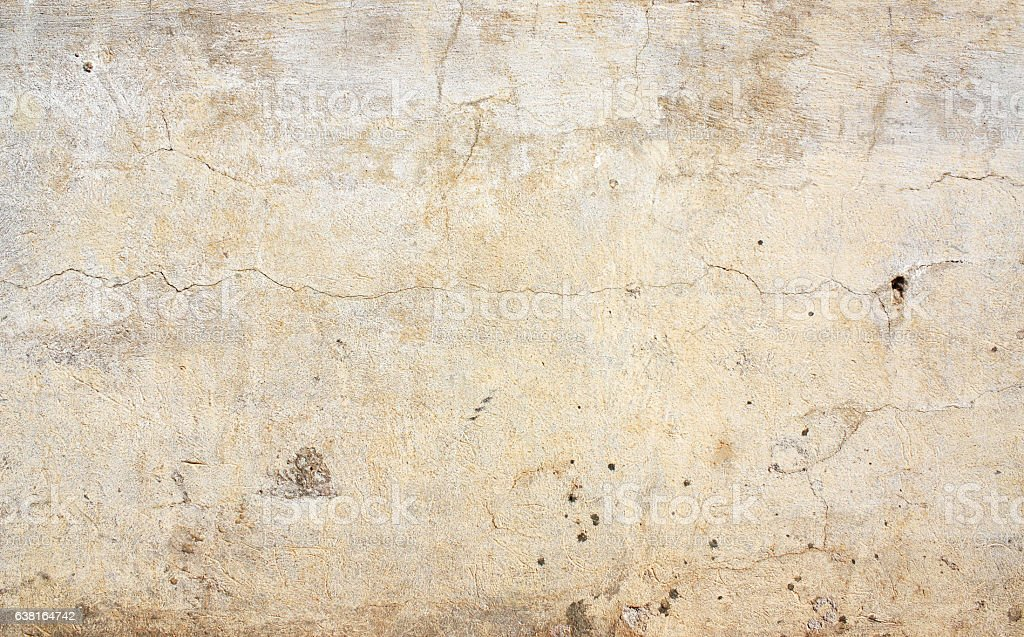 Old stucco wall texture of beige color stock photo