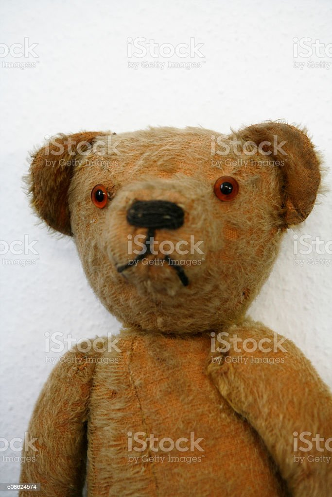 Old stuffed Teddybear rag doll stock photo