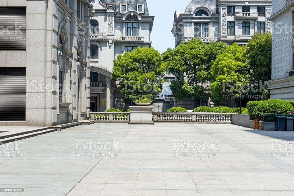 old style building with empty road floor stock photo