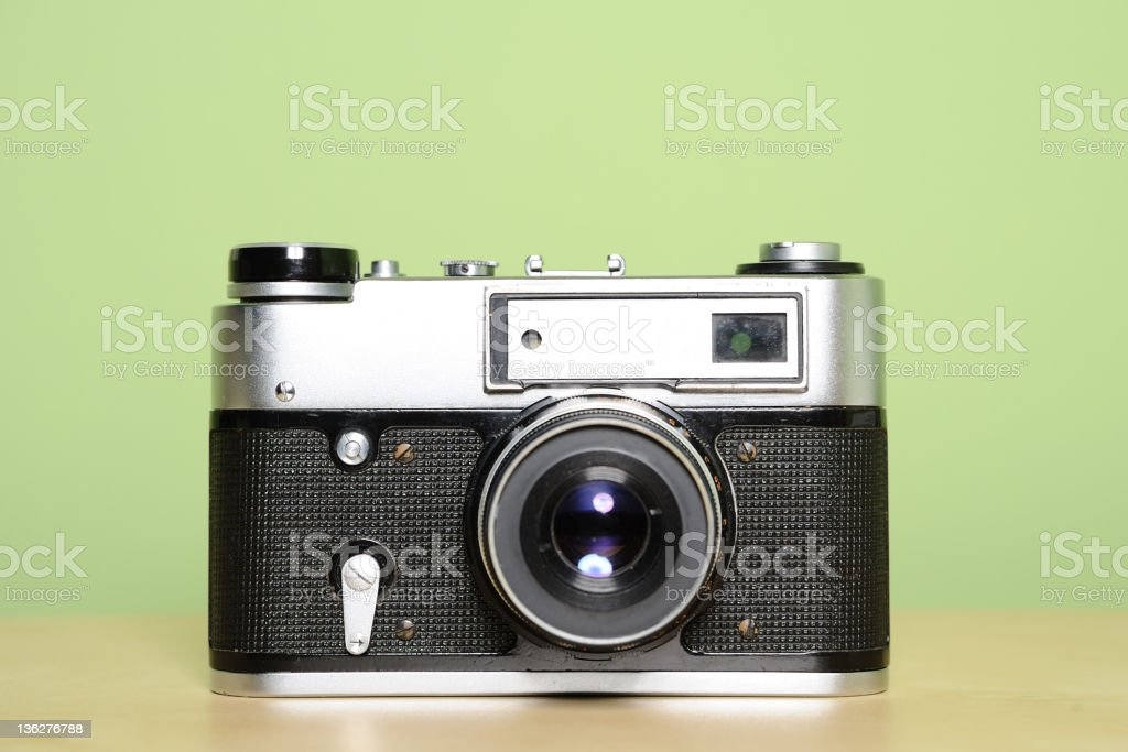 Old style camera on table stock photo