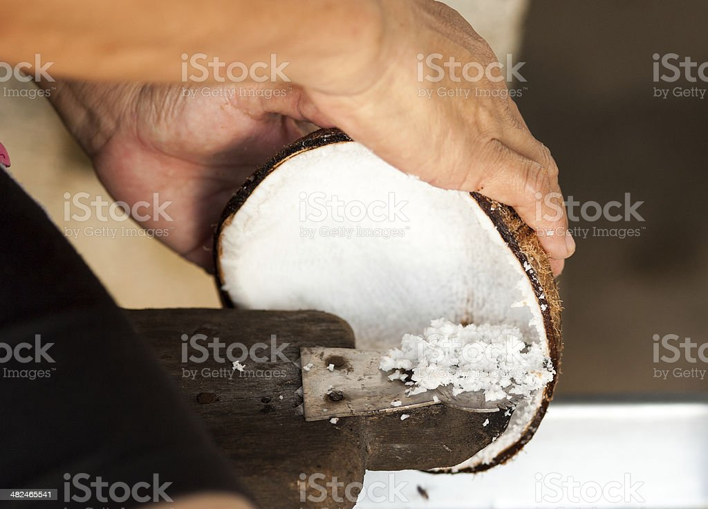 old style coconut milk making by hand stock photo