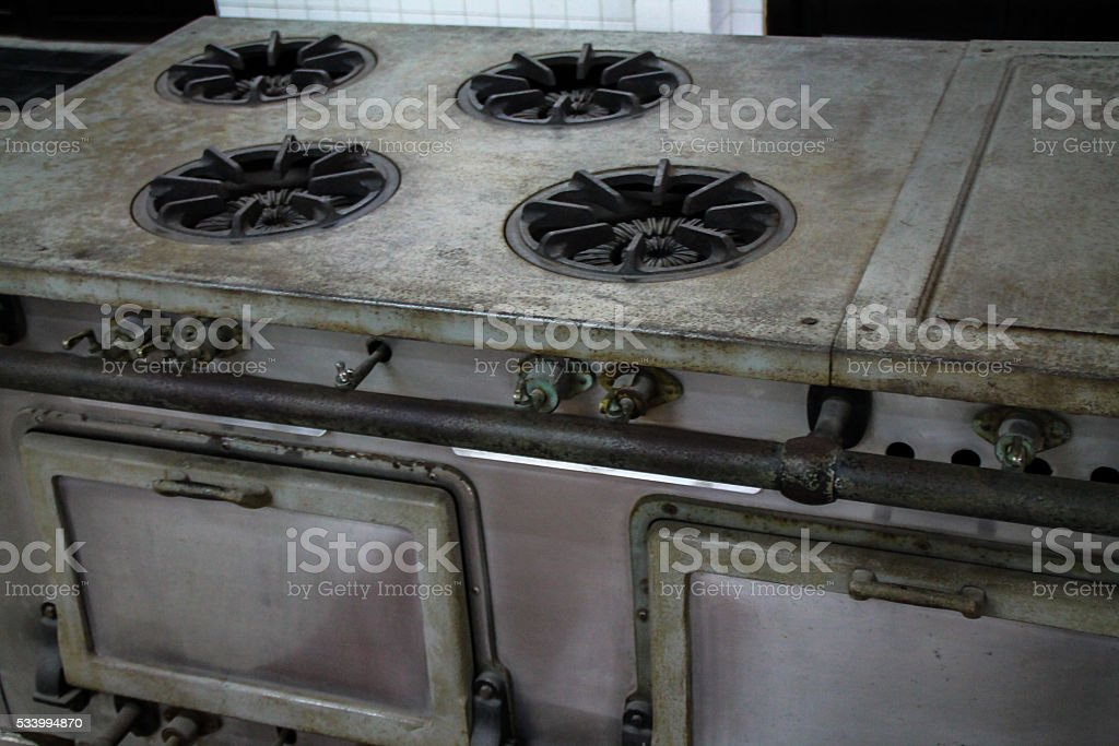 Old style commercial cooking stove top and oven. stock photo