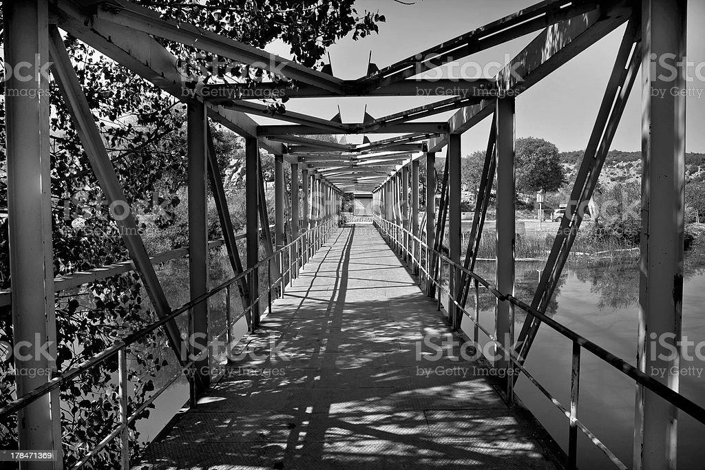 Old style iron river bridge stock photo