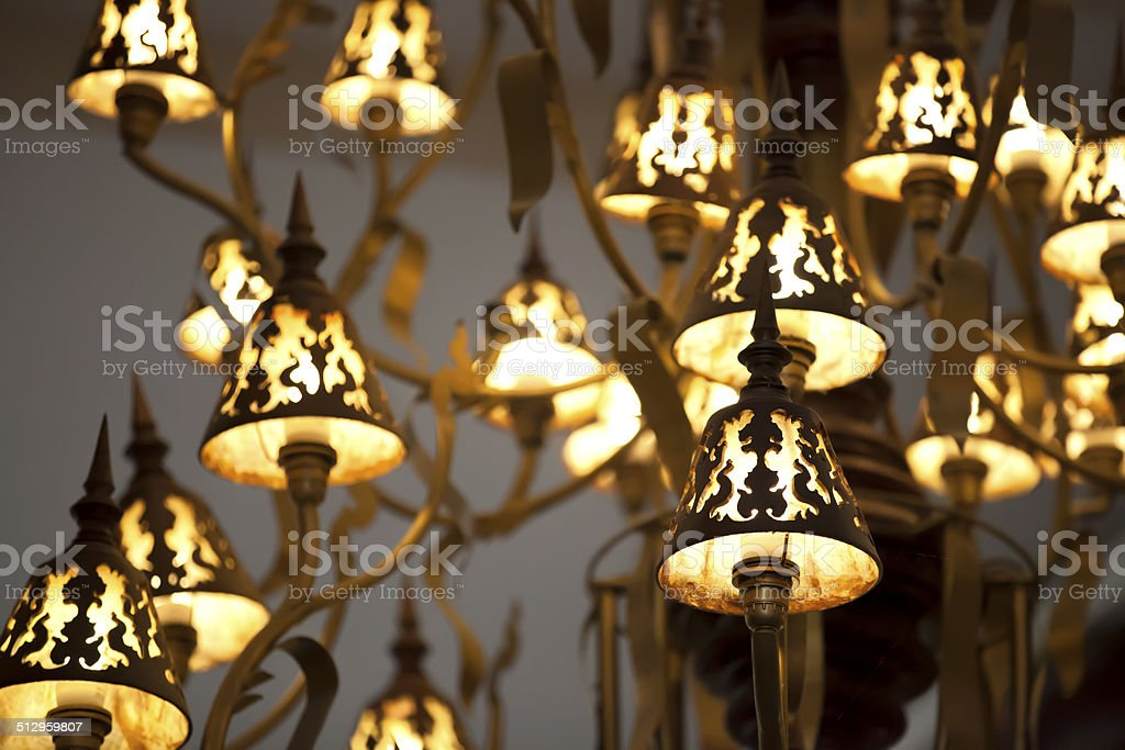old style lamps on chandelier, abstract wallpaper stock photo