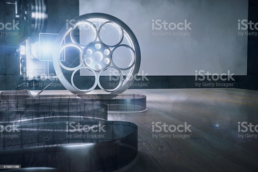 Old style movie camera and film on wooden table stock photo