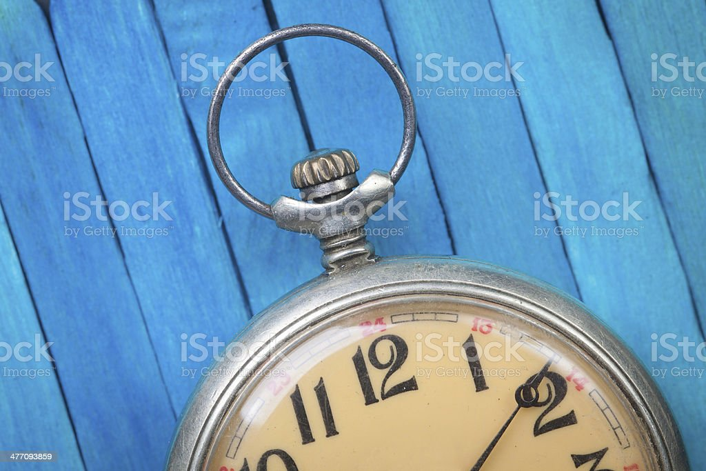 old style pocket watch on blue wooden backround royalty-free stock photo