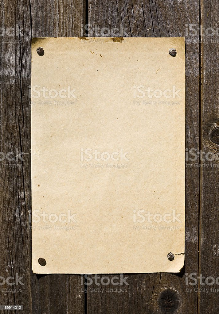 Old Style Retro Paper On Wooden Wall stock photo