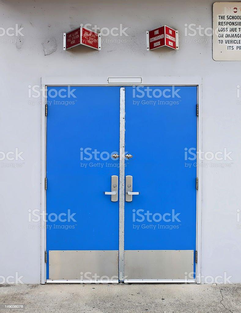 old style school door with fire alarm above stock photo