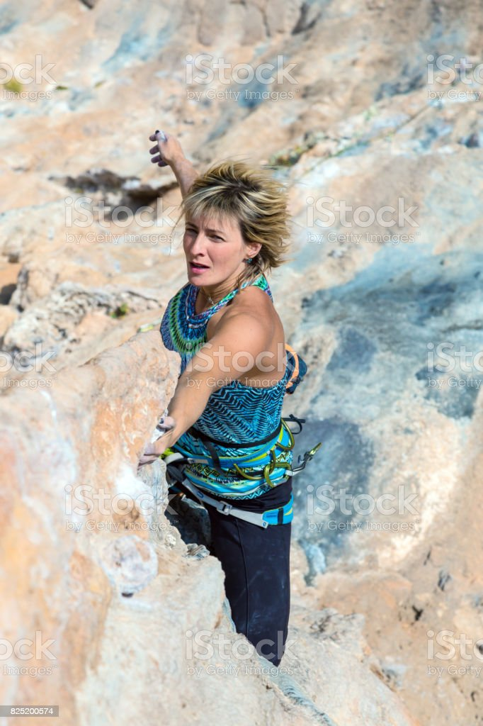 Old Style toned Portrait of female Rock Climber stock photo