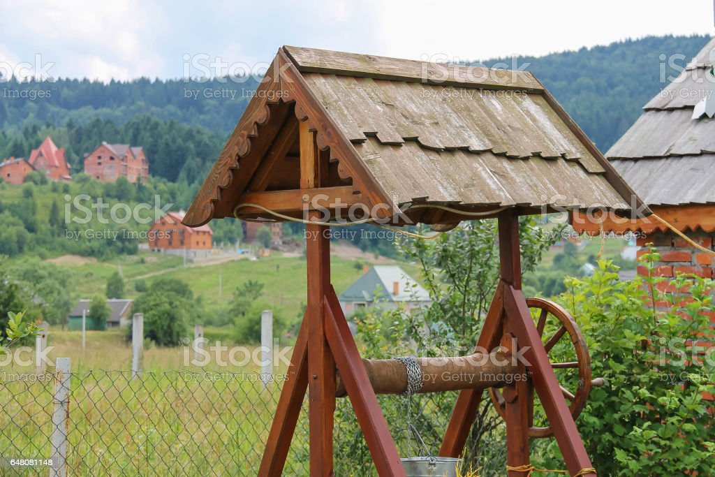 Old style wooden well. Ukraine stock photo