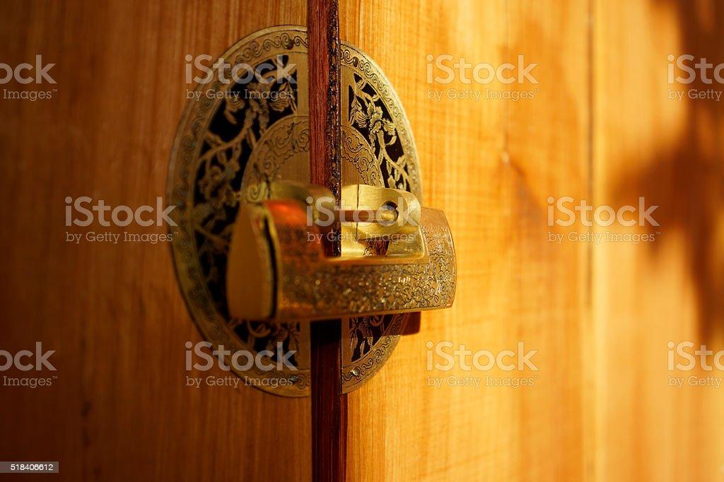 old styled golden lock on wooden door stock photo