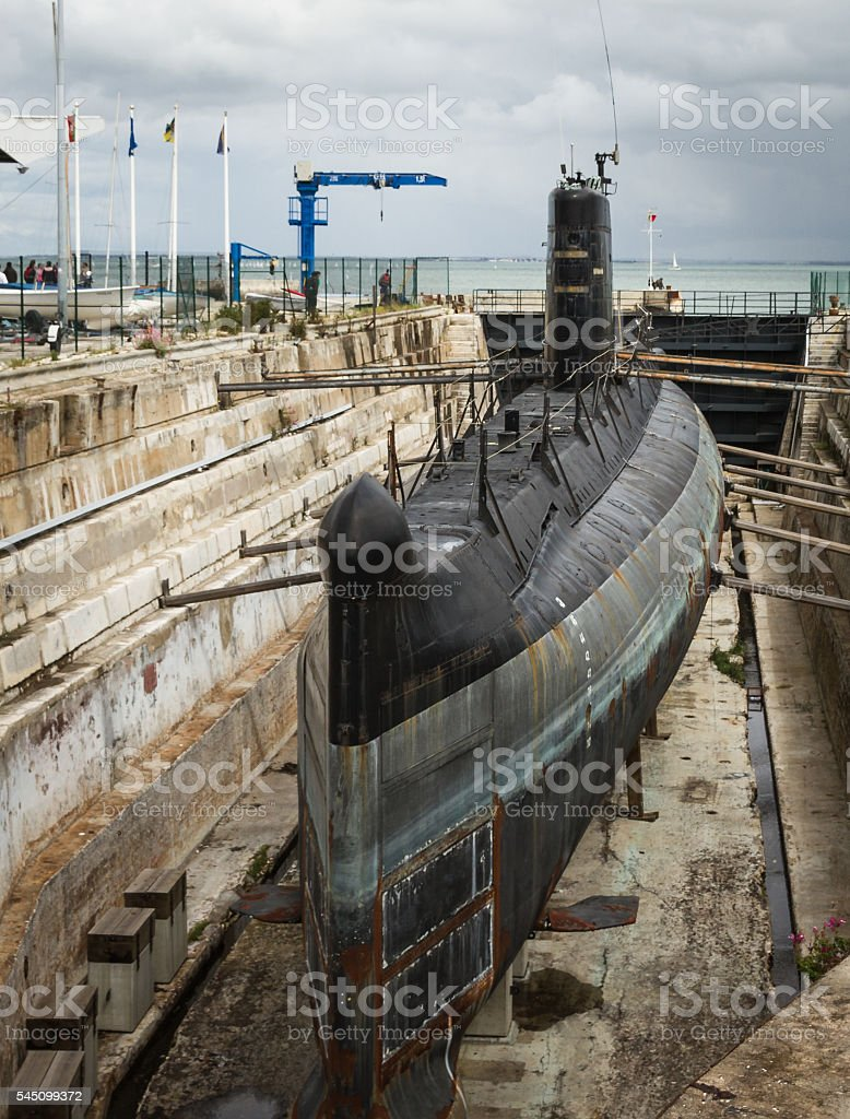 old submarine surfaced stock photo