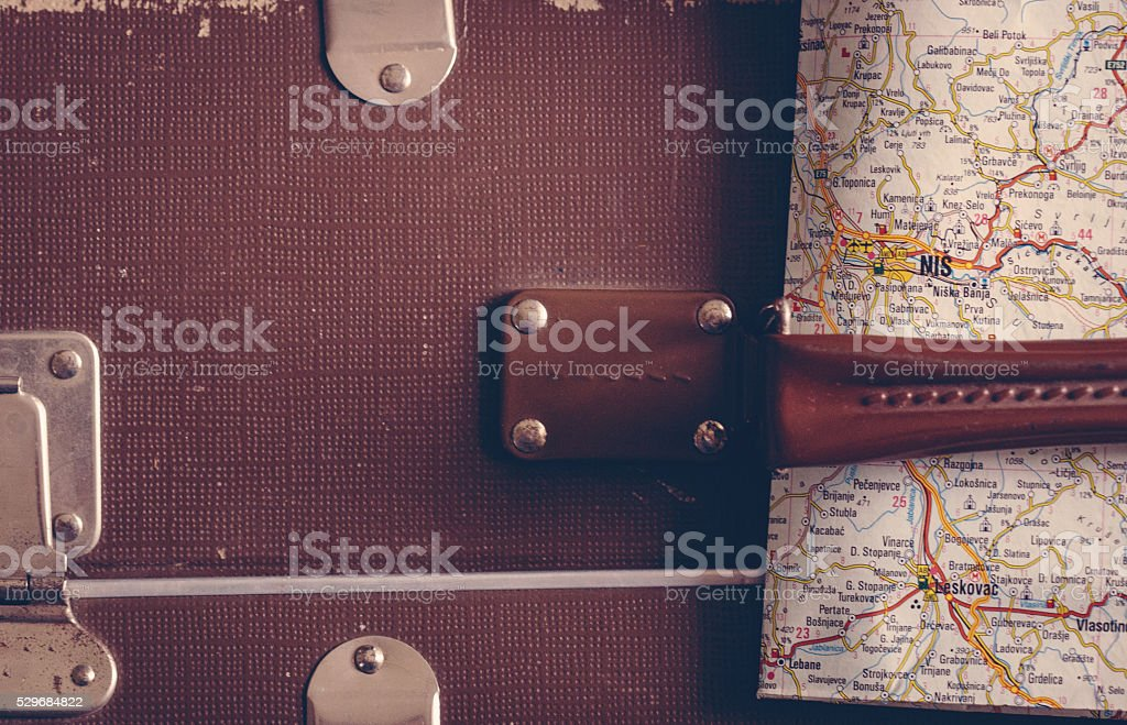 Old suitcase and a map stock photo