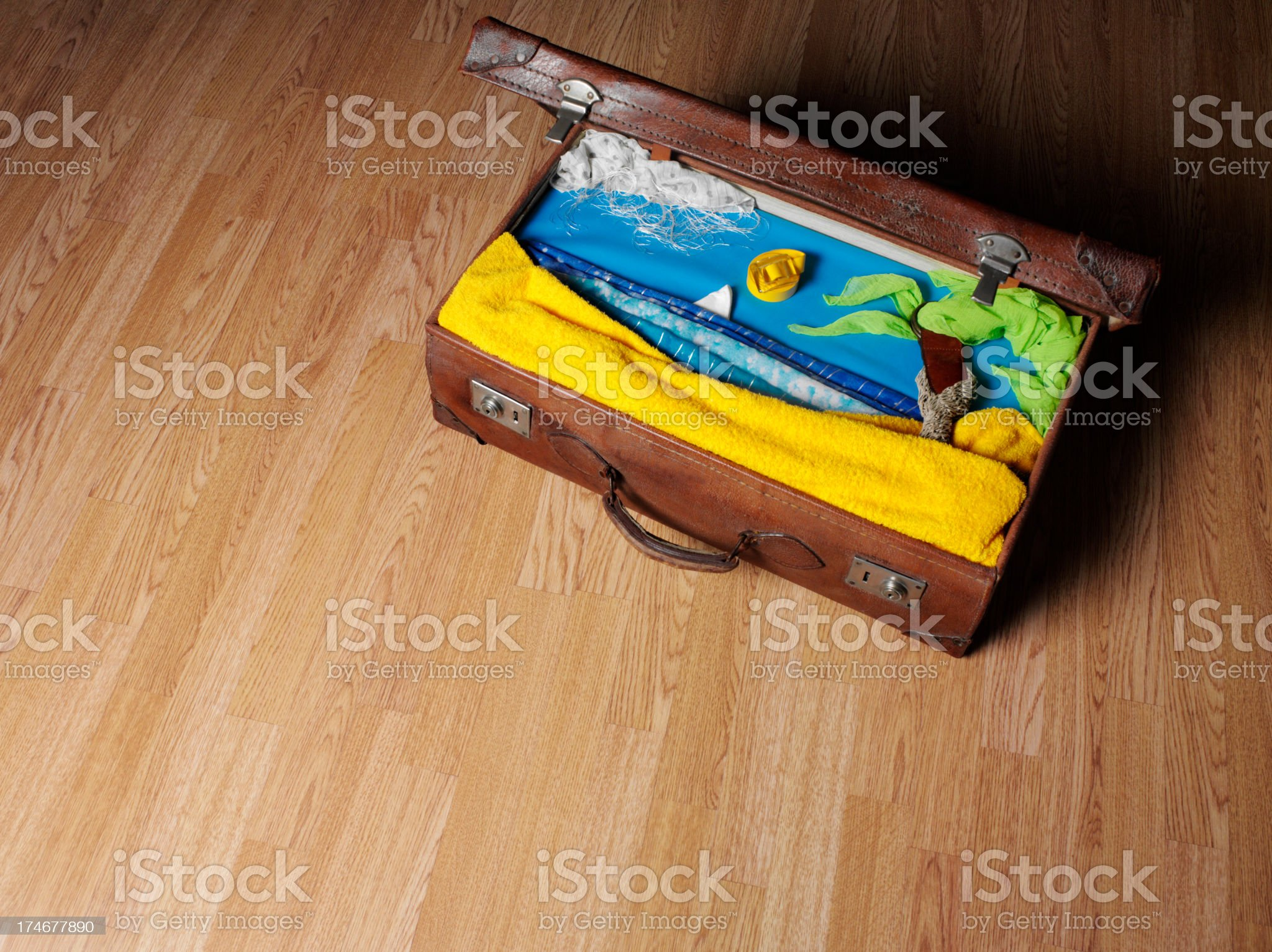 Old Suitcase Packed with Summer Clothes royalty-free stock photo