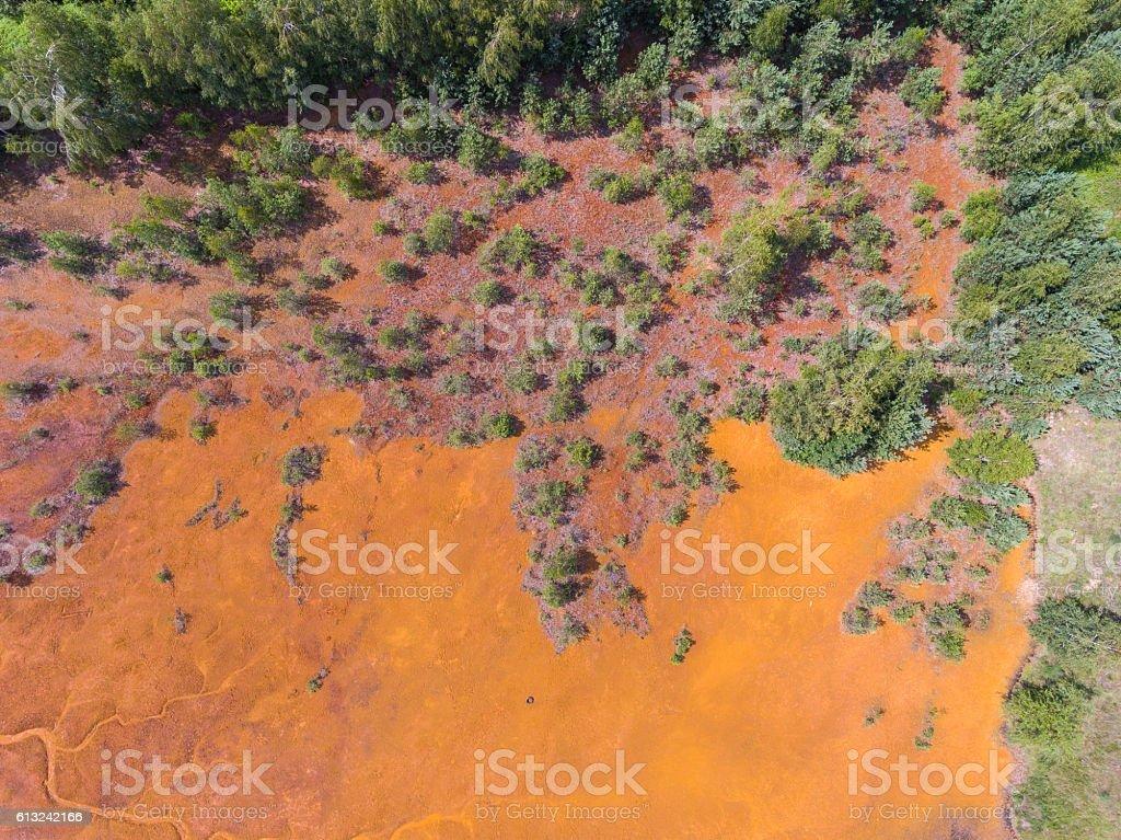 Old sulfuric acid natural tank orange color in  Poland. stock photo